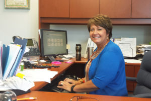 Teresa Crawford at her desk on the SFSC Hardee Campus.